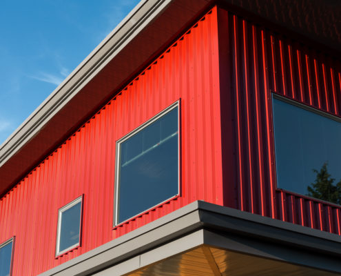 Delgado Architect Commercial Building Deep Rib Metal Siding